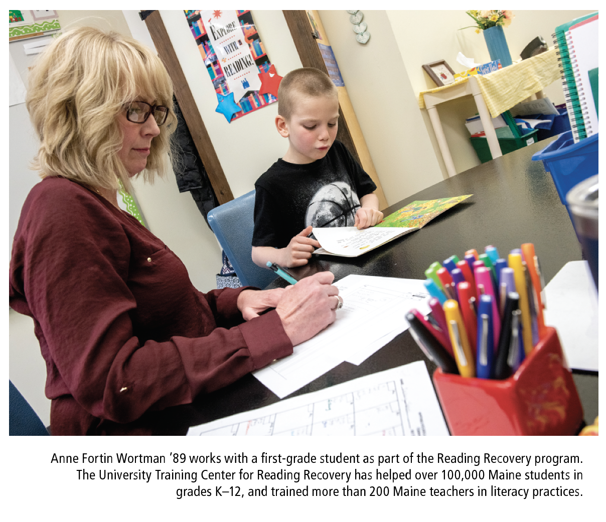 Anne Fortin Wortman '89 works with a first-grade student as part of the Reading Recovery program. The University Training Center for Reading Recovery has helped over 100,000 Maine students in grades K–12, and trained more than 200 Maine teachers in literacy practices.
