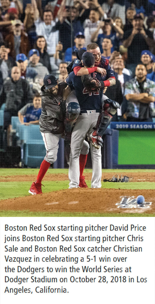 "Photo with caption: ""Boston Red Sox starting pitcher David Price joins Boston Red Sox starting pitcher Chris Sale and Boston Red Sox catcher Christian Vazquez in celebrating a 5-1 win over the Dodgers to win the World Series at Dodger Stadium on October 28, 2018 in Los Angeles, California."""