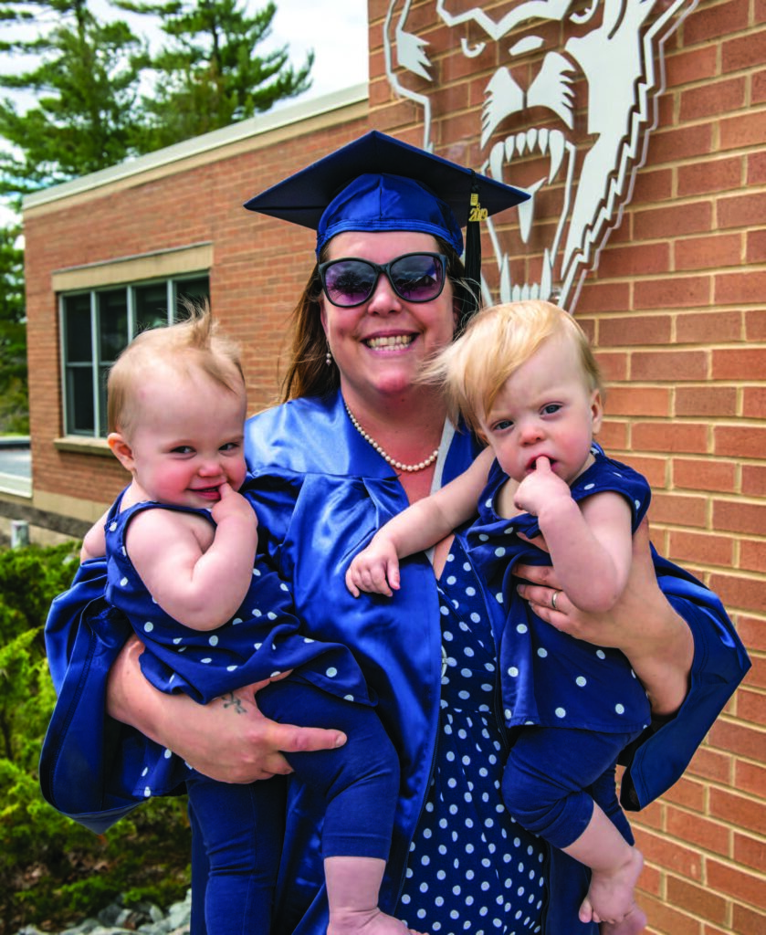 McDonald chose to wait until the following year to participate in UMaine's annual commencement ceremonies, which her one-year-olds attended.