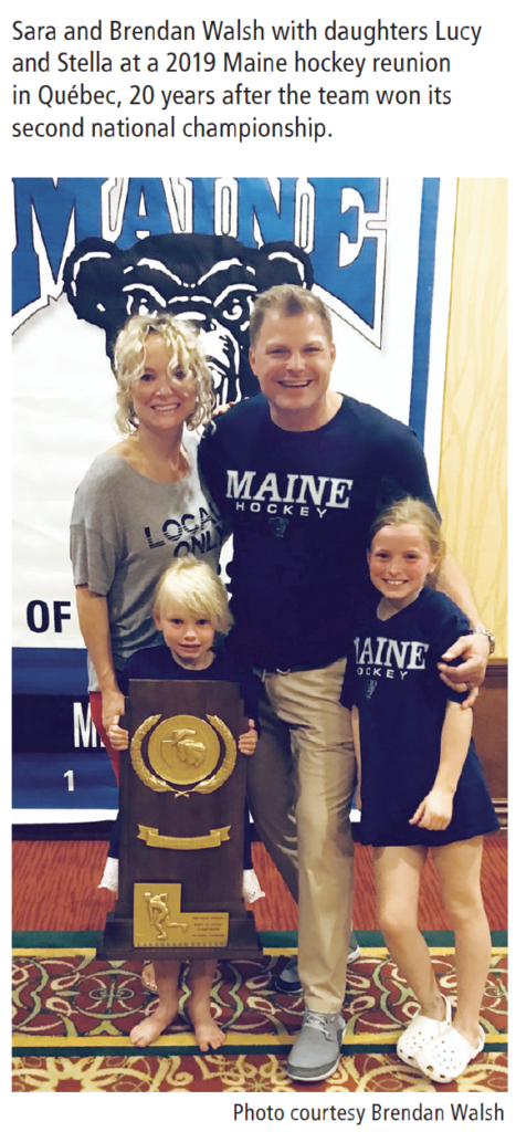 Sara and Brendan Walsh with daughters Lucy and Stella at a 2019 Maine hockey reunion in Québec, 20 years after the team won its second national championship.